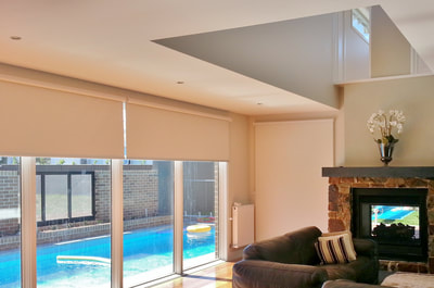 Luxaflex Roller blinds in Atmosphere fabric - by Eureka B&C with Duraguard to resist most stains & Sanitized antibacterial treatment with noise reduction bumpers on base rails