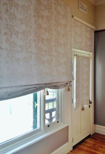 Custom Roman blind with Swag base & Tassels on tabs, with co-ordinating Bonded Roller blinds - by Eureka B&C